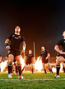 All Blacks performing haka with fireworks in background
