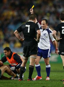 Referee Jaco Peyper gives a yellow card to Beauden Barrett Australia v New Zealand