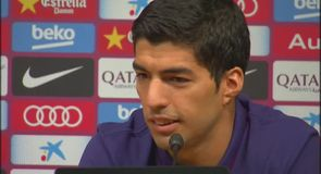 Suarez promises he won't bite again