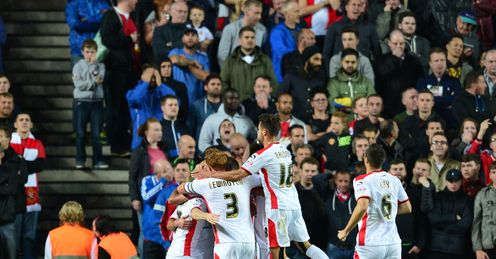 MK Dons celebrate knocking Man United out of the League Cup