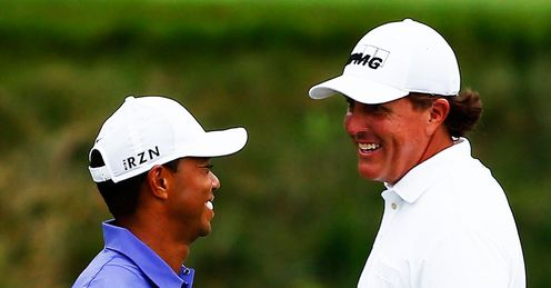 Woods laughs off McIlroy jibe