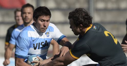 ARGENTINA'S LOS PUMAS' WING LUCAS GONZALEZ AMOROSINO (L) RUNS THROUGH A TACKLE BY SOUTH AFRICA'S SPRINGBOKS' HOOKER BISMARCK DU PLESSIS