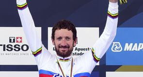 Sir Bradley Wiggins secured the fabled rainbow jersey in Ponferrada