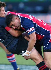 Ben Funnell of Canterbury is tackled by Kiero 3218006 Robertson safe despite Tasman loss