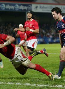 Nili Latu of Tonga scores v USA 3229606 Latu leads Tonga in Kilmarnock