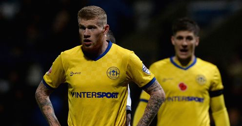 McClean helps Wigan past Leeds
