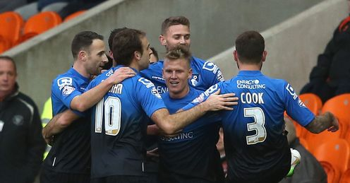 Leaders Bournemouth hit six