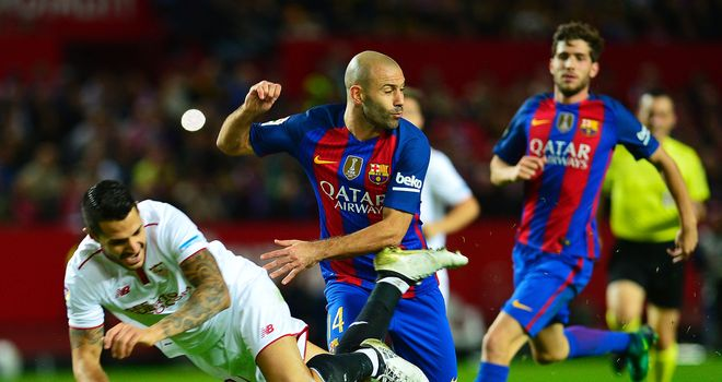 Lionel Messi was booked for time wasting as Barcelona looked to see out a 2-1 victory at Sevilla and the Argentine was not happy with the referee's decisions