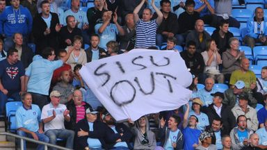 Coventry fans invade pitch in protest
