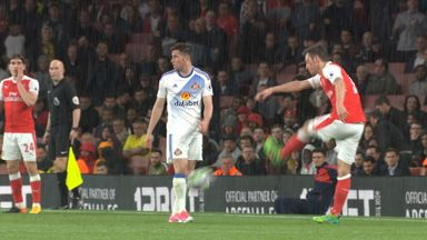 Frustrated Ozil boots ball