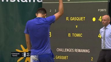 Tomic saves match point in style!