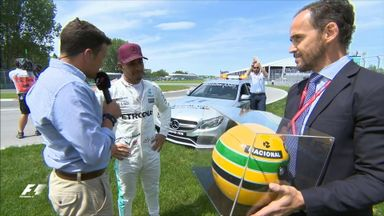 Lewis receives Senna helmet