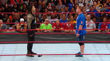 Roman Reigns confronts John Cena