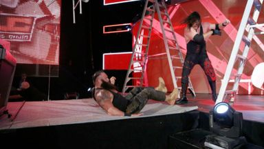 Kane chokeslams Braun off the stage!
