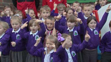Coleman visits Bradley's school