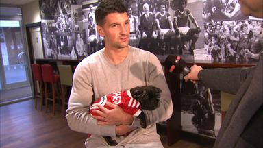 Lichaj introduces Gunner the dog