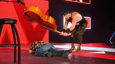Strowman bashes Elias with a cello!