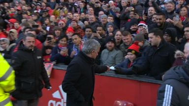 Jose hands kid his notes