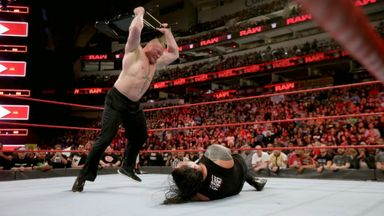 Lesnar viciously attacks Reigns