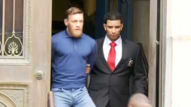 McGregor leaves in handcuffs