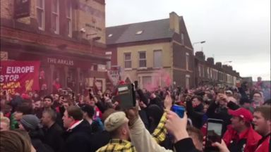 Liverpool fans welcome their team's bus