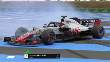 Grosjean crashes into the barriers