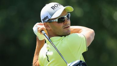 Kaymer tied for lead at home